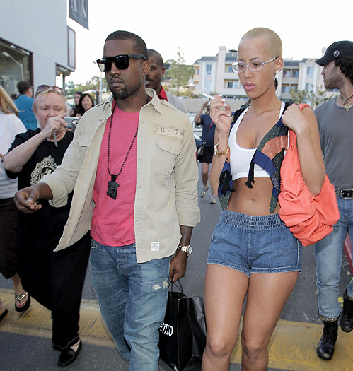 Kanye went from too much hair to an even cut and arm candy with no hair. She's cute though.