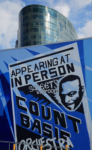 "A section of the mural outside of the Power & Light designed by Alexander Austin. It stretches across two buildinds. This piece is flanked by the likenesses of two Kansas City legends, jazz icon Charlie ""Bird"" Parker and Negro Leagues great Satchel Paige."